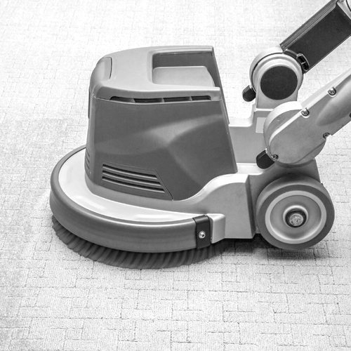 Carpets chemical cleaning with professionally disk machine.