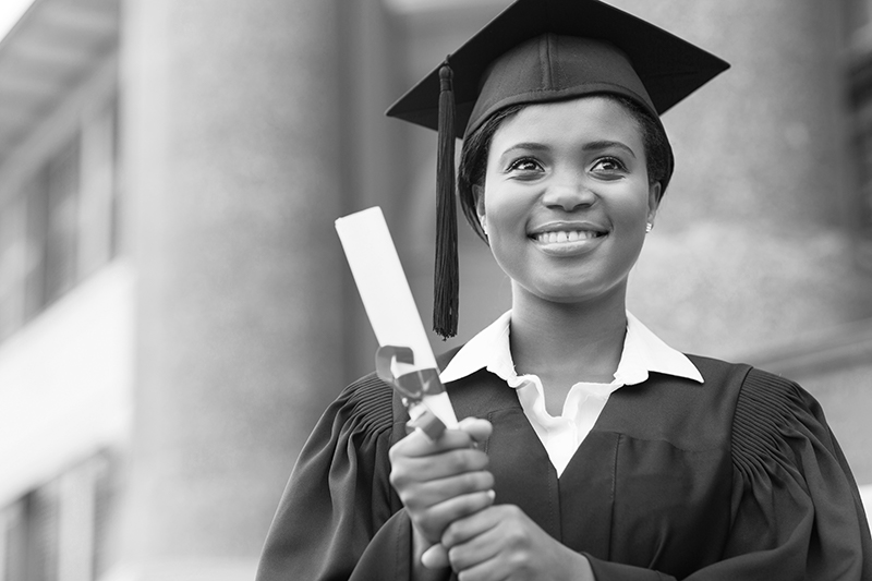 Female grad holding diploma