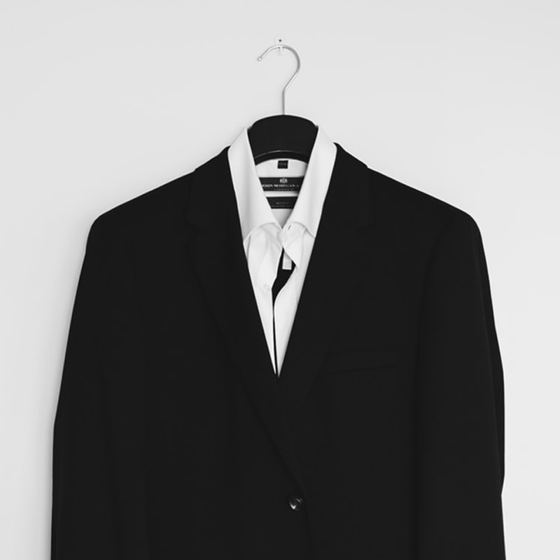 Business suit and shirt on a hanger